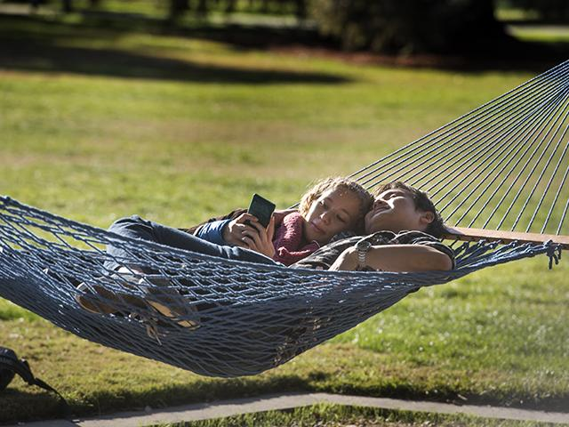 couple snuggling in hammock