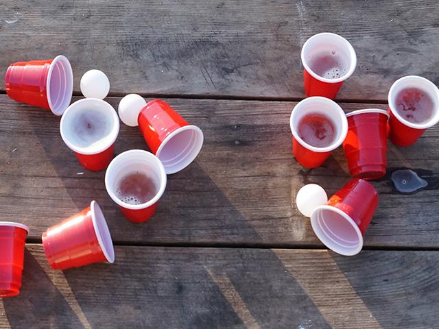 clear signs of beer pong -- red cups and ping pong balls