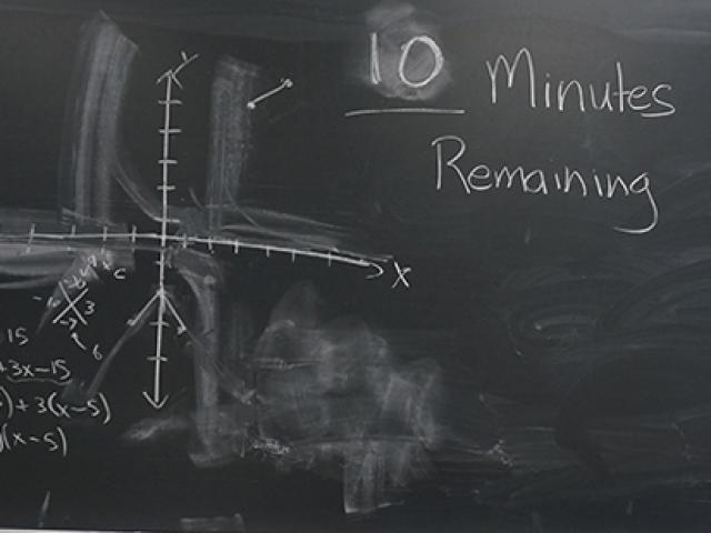 blackboard showing minutes remaining in an exam